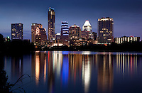 The beloved Austin Skyline seen off the calm, mirror-like waters of Town Lake, Lake Austin
