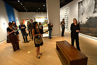 NWA Democrat-Gazette/ANDY SHUPE<br /> Manuela Well-Off-Man (right), chief curator at the IAIA Museum of Contemporary Native Arts in Santa Fe, N.M., speaks Thursday, Oct. 4, 2018, about a piece titled, &quot;Ozark (Shelter in Place),&quot; by artist Athena LaTocha during a tour of a new exhibition of artwork by Native American artists at Crystal Bridges Museum of American Art in Bentonville. The exhibition, titled &quot;Art for a New Understanding: Native Voices, 1950s to Now,&quot; opens today and runs through Jan. 7, 2019.