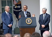 United States President Barack Obama, center, introduces Judge Merrick Garland, chief justice for the US Court of Appeals for the District of Columbia Circuit, right, as his nominee to replace the late Associate Justice Antonin Scalia on the U.S. Supreme Court in the Rose Garden of the White House in Washington, D.C. on Wednesday, March 16, 2016. US Vice President Joe Biden looks on from left.<br />