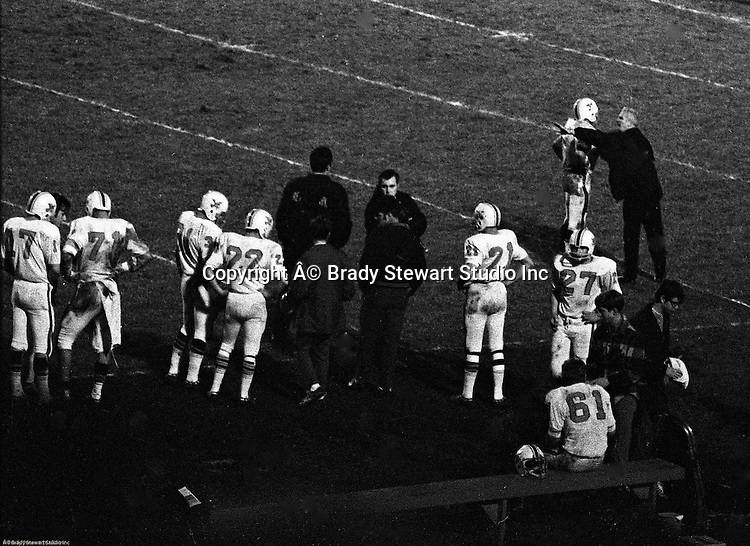 Bethel Park PA:  Coach Andabaker and Mike Stewart talking strategy during the Upper St Clair game.  Others in the photo; Coach Eisaman, Coach Mongelluzzo, Glenn Eisaman 71, Jeff Tate 22, John Bender 27, Mike Stewart 11, Ray Tedesco 61, Gary Biro 81, Scott Streiner 17,  Vic Tedesco 31.  The Bethel Park offense and defense played very well in the 16-0 shut out of the Upper St Clair Panthers.  The defensive unit was one of the best in Bethel Park history only allowing a little over 7 points a game.