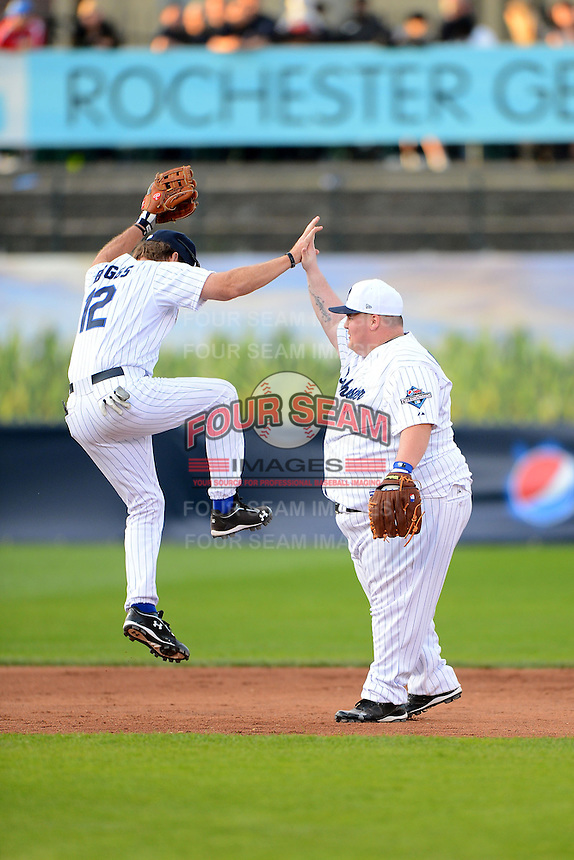 Hall of Fame third baseman Wade Boggs #12 high fives contest winner Johnny Perotti after a play during the MLB Pepsi Max Field of Dreams game on May 18, 2013 at Frontier Field in Rochester, New York.  (Mike Janes/Four Seam Images)