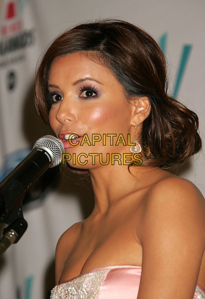 EVA LONGORIA.Press conference for the 2006 American Latino Media Arts Awards held at the Peninsula Hotel, Beverly Hills, California, USA, 04 April 2006..portrait headshot funny mouth speaking microphone.Ref: ADM/RE.www.capitalpictures.com.sales@capitalpictures.com.©Russ Elliot/AdMedia/Capital Pictures.