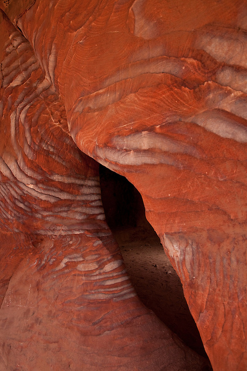 Dramatically colored bands of Nubian sandstone dominate many of the tomb caves of Petra, Jordan