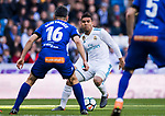 Carlos Henrique Casemiro (R) of Real Madrid is tackled by Daniel Alejandro Torres Rojas, D Torres, of Deportivo Alaves during the La Liga 2017-18 match between Real Madrid and Deportivo Alaves at Santiago Bernabeu Stadium on February 24 2018 in Madrid, Spain. Photo by Diego Souto / Power Sport Images