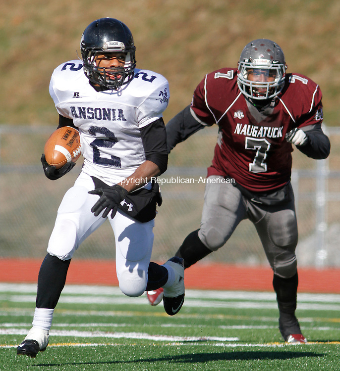 Naugatuck, CT-112813MK16  Ansonia's Arkeel Newsome (2) rushes away from Naugatuck's Jourdan Hopkins (7) during Thanksgiving morning NVL football action at Naugatuck High School.  Ansonia handed Naugatuck their first defeat on the new astroturf 66 to 28. Michael Kabelka / Republican-American