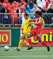 02 May 2009: Columbus Crew forward Alejandro Moreno #10 and Toronto FC defender Adrian Serioux #15 in action at BMO Field in a game between the Columbus Crew and Toronto FC. .The game ended in a 1-1 draw..