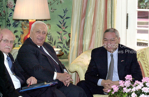 United States Secretary of State Colin Powell welcomes Prime Minister Ariel Sharon of Israel to the Blair House in Washington, D.C. on Monday, March 19, 2001 for talks on the situation in the Middle East. At far left is the Ambassador of Israel to the United States David Ivry..Credit: Ron Sachs / CNP