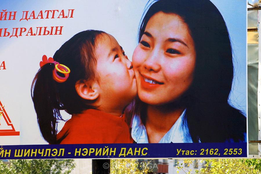 GOBI DESERT, MONGOLIA..09/03/2001.Bayanhongor (Bayankhongor). Advertising billboard..(Photo by Heimo Aga).