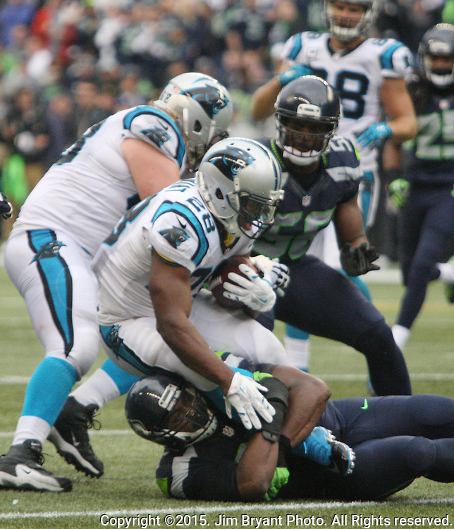 Seattle Seahawks  linebacker K.J. Wrights brings down Carolina Panthers  running back Jonathan Stewart (28) at CenturyLink Field in Seattle on October 18, 2015. The Panthers came from behind with 32 seconds remaining in the 4th Quarter to beat the Seahawks 27-23.  ©2015 Jim Bryant Photography. All Rights Reserved.