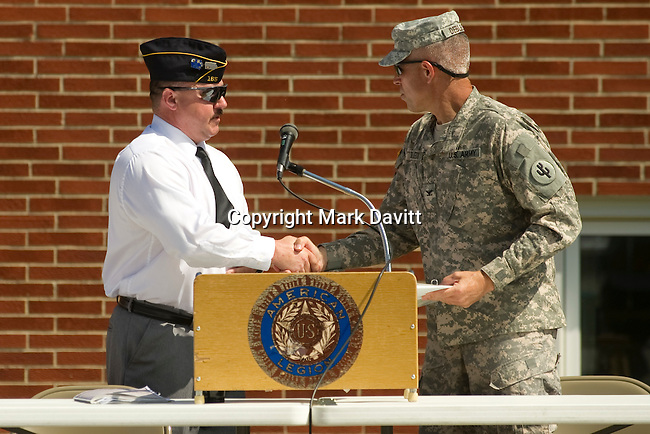 Lonnie Hoyt of Post 165 welcomes speaker Arlan DeBlieck during the services