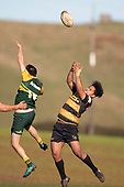 Conner Brooke-Cowden and Rupeni Unga compete for the high ball. Counties Manukau Premier Club Rugby game between Bombay and Pukekohe, played at Bombay on Saturday June 30th 2018.<br /> Bombay won the game 24 - 14 after leading 24 - 0 at halftime.<br /> Bombay 24 - Sepuloni Taufa, Tulele Masoe, Chay Mackwood, Liam Daniela tries, Ki Anufe 2 conversions.<br /> Pukekohe Mitre 10 Mega 14 - Joshua Baverstock, Gregor Christie tries; Cody White 2 conversions.<br /> Photo by Richard Spranger.