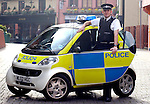 Police Sergeant James Brown with the Smart patrol car .on trial with the Norfolk Constabulary.