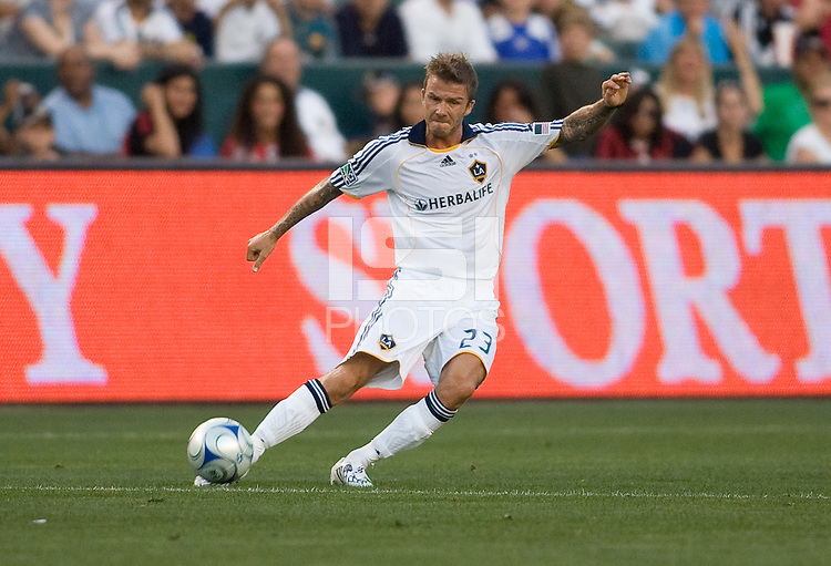 A sleeveless David Beckham of the LA Galaxy  upon his return from Europe sends a ball across the middle. AC Milan played the LA Galaxy to a 2-2 tie in an International friendly match at Home Depot Center stadium in Carson, California on Sunday July 19, 2009. .