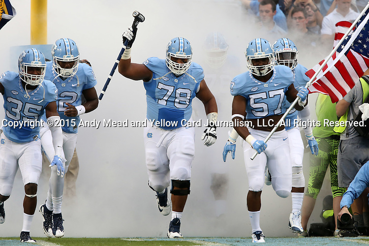 12 September 2015: UNC's Marlon Pett (57), Landon Turner (78), and Damien Washington (35) lead the team onto the field. The University of North Carolina Tar Heels hosted the North Carolina A&T State University Aggies at Kenan Memorial Stadium in Chapel Hill, North Carolina in a 2015 NCAA Division I College Football game.