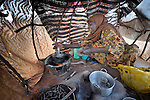 Halima Abdikadir Hassan, 45, making food in her cooking tent, arrived in the Dadaab refugee camp in northeastern Kenya in March, 2011. Tens of thousands of refugees have fled drought-stricken Somalia in recent weeks, swelling what was already the world's largest refugee settlement.