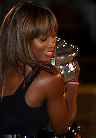 Serena Williams with the Australian Open Women's Trophy after beating Justine Henin..International Tennis - Australian Open Tennis - Sat 30  Jan 2010 - Melbourne Park - Melbourne - Australia ..© Frey - AMN Images, 1st Floor, Barry House, 20-22 Worple Road, London, SW19 4DH.Tel - +44 20 8947 0100.mfrey@advantagemedianet.com