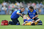 Eoin Cleary of Clare is checked out for an injury during their Munster championship quarter-final game against Limerick in Cusack park. Photograph by John Kelly.