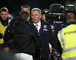 Ally McCoist shellshocked at the final whistle as goes to congratulates the QOS bench
