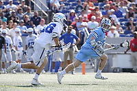 Annapolis, MD - May 20, 2018: Johns Hopkins Blue Jays Joel Tinney (55) takes the ball away from Duke Blue Devils Peter Conley (66) during the quarterfinal game between Duke vs John Hopkins at  Navy-Marine Corps Memorial Stadium in Annapolis, MD.   (Photo by Elliott Brown/Media Images International)