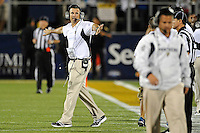 1 September 2011:  FIU Head Football Coach Mario Cristobal directs players and coaches back to the sidelines in the second half as the FIU Golden Panthers defeated the University of North Texas, 41-16, at University Park Stadium in Miami, Florida.