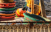 Colorful baskets and floats and rings for nets of fishing boat in Engelhard, Hyde County, NC