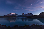 Predawn view of the Paine Massif with reflections.  Left to right - Cerro Paine Grande, the Cuernos del Paine, or Horns, and Monte Almirante NIeto.  Lake Pehoe is in the foreground.  Taken from Hosteria Pehoe island.  Torres del Paine National Park in Patagonia, Chile.  A UNESCO World Biosphere Reserve.