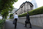 Pedestrians walk past the Bank of Japan on September 21, 2016, Tokyo, Japan. The Bank of Japan (BOJ) announced it would modify its monetary policy framework on Wednesday by expanding the monetary base until inflation is stable above the 2% target it set more than three years ago. It also said that it would aim to keep yields on 10-year government bonds at current levels around zero percent. In reaction to Japan's central bank decision the Nikkei 225 Stock Average closed up 1.91 percent to 16,807.62. (Photo by Rodrigo Reyes Marin/AFLO)