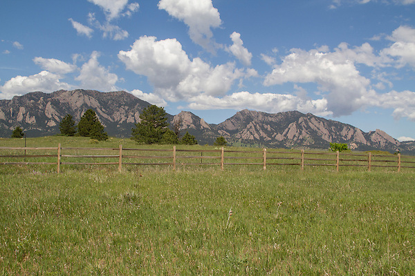 Split-rail fence and meadow with the Flatirons rock formation, Boulder, Colorado, .  John leads private photo tours in Boulder and throughout Colorado. Year-round Colorado photo tours.