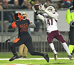 Belleville West's Jaylan McCray (right) makes an interception on the pass intended for Edwardsville's Kenyon Johnson in the first half. Belleville West played Edwardsville in a Southwestern Conference football game on Friday October 12, 2018.