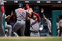 Lehigh Valley IronPigs Matt McBride (30) high fives Jan Hernandez (16) after hitting a home run during an International League game against the Buffalo Bisons on June 9, 2019 at Sahlen Field in Buffalo, New York.  Lehigh Valley defeated Buffalo 7-6 in 11 innings.  (Mike Janes/Four Seam Images)