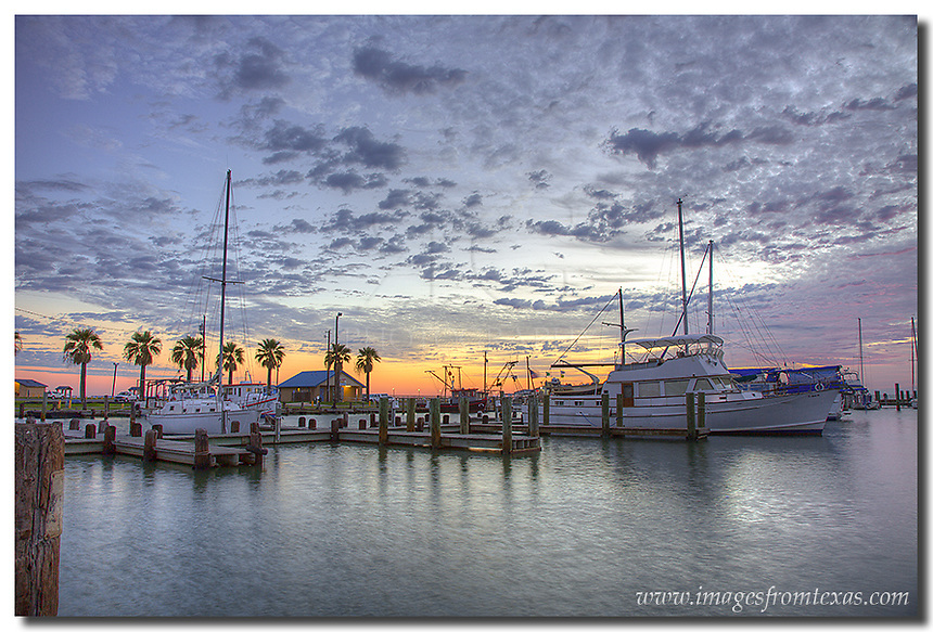 On a cool October morning, the boats in Rockport Harbor rest quietly as the sun begins to make its ascent. Along the Texas coast, scenes like this make it a great place to visit and photograph. On this moring, it was just the seagulls, the incoming shrimp boats, and me.