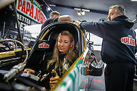 Feb 10, 2017; Pomona, CA, USA; Crew members with NHRA top fuel driver Leah Pritchett during qualifying for the Winternationals at Auto Club Raceway at Pomona. Mandatory Credit: Mark J. Rebilas-USA TODAY Sports
