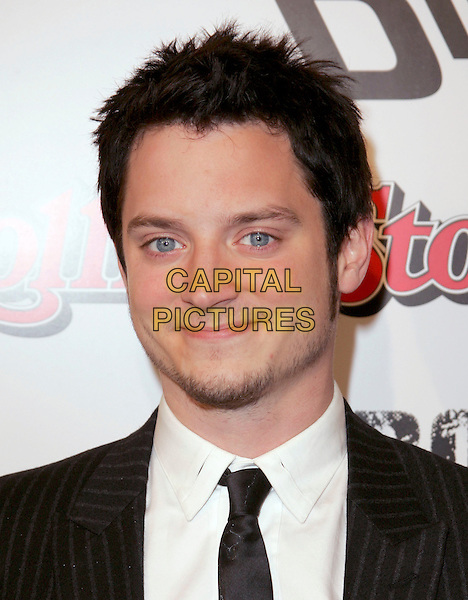 "ELIJAH WOOD.attends Dimension Films' World Premiere of ""Sin City"" held at The Mann National Theater in Westwood, California, USA, on March 28th 2005..portrait headshot beard facial hair stubble.Ref: DVS.www.capitalpictures.com.sales@capitalpictures.com.©Debbie VanStory/Capital Pictures"