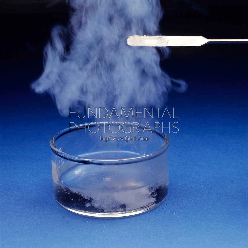 PHOSPHORUS PENTOXIDE REACTS WITH WATER (2 of 2)<br /> Phosphorus Pentoxide  Dropped Into The Water<br /> P4O10(s) is dropped into water forming phosphoric acid and generating enough heat to create steam in an exothermic reaction<br /> P4O10(s) + 6 H2O(l) --> 4 H3PO4(aq)