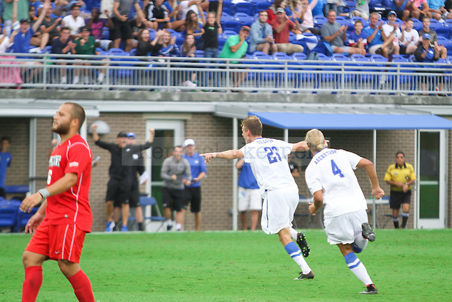 Kentucky junior Kristoffer Tollefsen runs toward his team after scoring during the University of Kentucky vs. Belmont men's soccer game at the Wendell and Vickie Bell Soccer Complex in Lexington, Ky., on Sunday, August 31, 2014. Photo by Jonathan Krueger | Staff