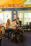 USA, Oregon, Ashland, a young couple has breakfast at the Morning Glory Restaurant on Siskiyoui Blvd