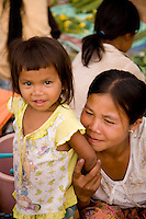 Woman with child at Evening Market near Pakse,Laos