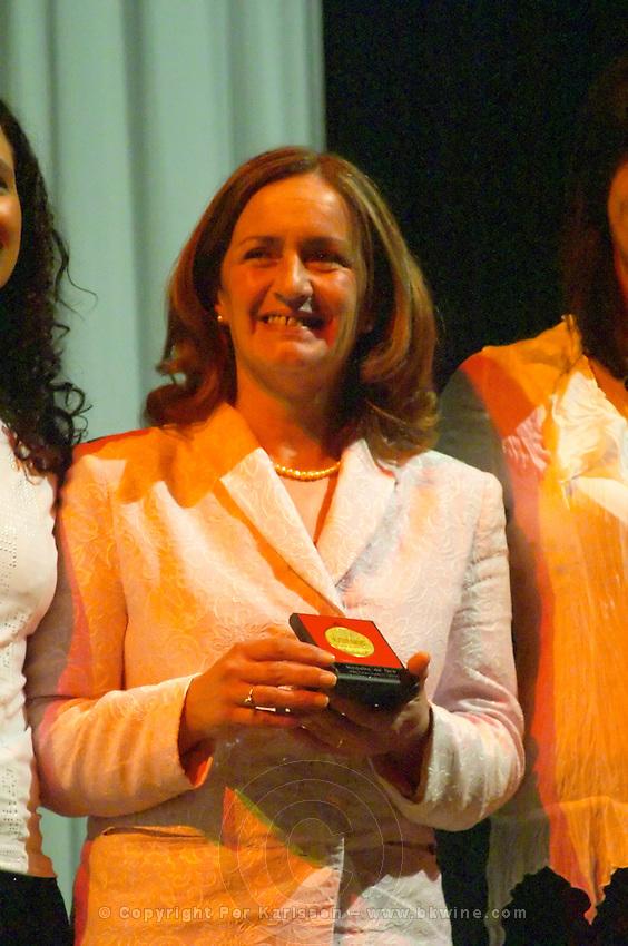 Graciela Seijas of Antigua Bodega San Jose winery, collecting the Uruguay Cata d'Or prize medal Catad'Or of Uruguay, Montevideo, Uruguay, South America