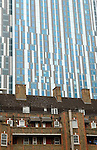 Nido student accomodation towering over traditional east London housing estate. Brune estate London E1. Tallest student accomocation in world.