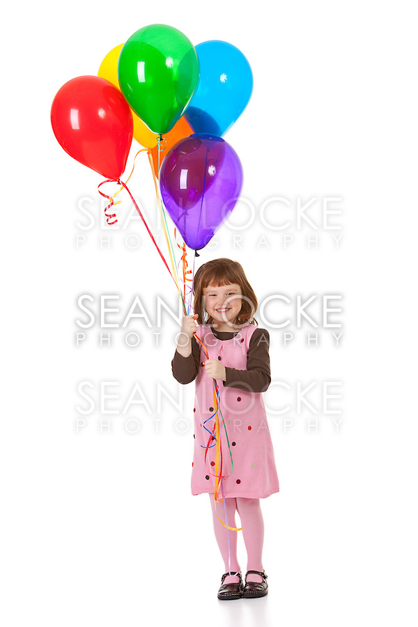 Cute little girl holding balloons.