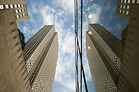 AVAILABLE FROM WWW.PLAINPICTURE.COM FOR LICENSING.  Please go to www.plainpicture.com and search for image # p5690250.<br /> <br /> Rockefeller Center - Upward View of 30 Rockefeller Plaza (the General Electric Building) with Clouds and Reflection, West 49th Street, Midtown Manhattan, New York City, New York State, USA