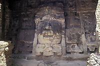 Huge limestone mask at the Mask Temple, Mayan ruins of Lamanai, Belize
