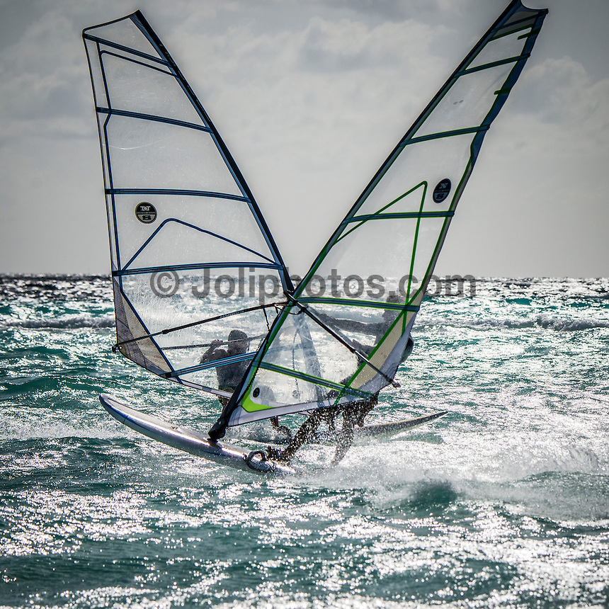 Four Seasons, Maldives (Monday, July 6, 2015) There was small south east swell today in the 2'-3' range There were surf sessions at Ninjas. The winds were strong SW Trades.  Photo: joliphotos.com