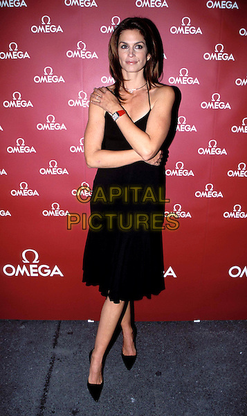 CINDY CRAWFORD.Launches The New OMEGA Advertising Campaign.black dress, arms folded, full length, full-length.www.capitalpictures.com.sales@capitalpictures.com.© Capital Pictures