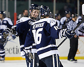 Grayson Downing (UNH - 28), John Henrion (UNH - 16) - The University of Maine Black Bears defeated the University of New Hampshire Wildcats 5-4 in overtime on Saturday, January 7, 2012, at Fenway Park in Boston, Massachusetts.