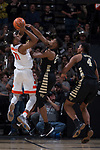 Terrence Thompson (20) of the Wake Forest Demon Deacons defends against Oshae Brissett (11) of the Syracuse Orange during second half action at the LJVM Coliseum on January 3, 2018 in Winston-Salem, North Carolina.  The Demon Deacons defeated the Orange 73-67.  (Brian Westerholt/Sports On Film)