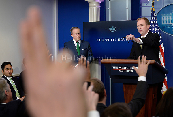 White House Press Secretary Sean Spicer looks on as Office of Management and Budget (OMB) Director Mick Mulvaney (R) speaks about the Fiscal Year 2018 budget proposed by United States President Donald J. Trump during the White House press briefing on March 16, 2017 in Washington, DC. <br /> Credit: Olivier Douliery / Pool via CNP /MediaPunch