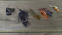 NWA Democrat-Gazette/FLIP PUTTHOFF <br /> Effective lures for catching river smallmouth bass include a buzz bait (from left), tube bait, jig and pig, small crawdad crank bait.