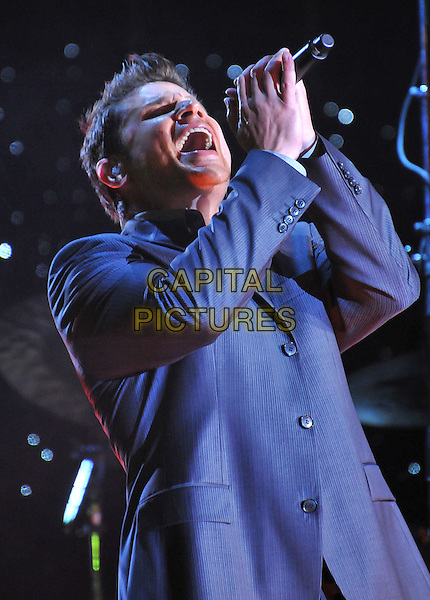 NICK LACHEY.McDonald's Family Tribute on Ice - Performance at the USC Galen Center, Los Angeles, California, USA..October 3rd, 2008.half length stage concert live gig performance music blue suit jacket singing .CAP/ADM/BP.©Byron Purvis/AdMedia/Capital Pictures.