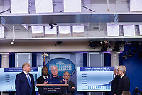 Admiral Brett Giroir, United States Assistant Secretary for Health makes remarks on the Coronavirus crisis in the Brady Press Briefing Room of the White House in Washington, DC on Saturday, March 21, 2020.  From left to right: US President Donald J. Trump; US Secretary of Housing and Urban Development (HUD) Ben Carson; Adm. Giroir; and Director of the National Institute of Allergy and Infectious Diseases at the National Institutes of Health Dr. Anthony Fauci.<br /> Credit: Stefani Reynolds / Pool via CNP/AdMedia